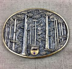 OC Tanner Belt Buckle Solid Brass Trees Forest PC Company 1981 Vintage  | eBay