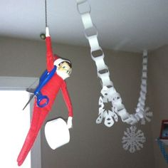 Elf decorates for Santa