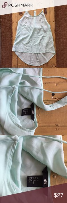 NWOT H&M HM BRAND MINT GREEN BOHO TANK TOP 4 NWOT H&M HM BRAND LIGHTWEIGHT MINT GREEN BOHO TANK TOP 4 Made in Indonesia Material: 100% polyester **PRICE FIRM-RARE AND SOLD OUT** All items come from a CLEAN, SMOKE-FREE home Open to ALL REASONABLE offers-Please give your BEST offer- I will do my best to work with you-Take advantage BUNDLING DISCOUNT! Modeling: Due to volume of items for sale,  I cannot accommodate modeling items-many items also for sale b/c they no longer fit me properly-thank…