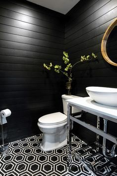 Give your powder room a modern, updated look using painted black shiplap. In a f… Give your powder room a modern, updated look using painted black shiplap. In a few simple steps, see how you transform your bathroom with shiplap. Warm Bathroom, Shiplap Bathroom, Bathroom Interior, Small Bathroom, Black Bathrooms, Bathroom Renovations, Bathroom Wall Ideas, Peach Bathroom, Black Bathroom Decor