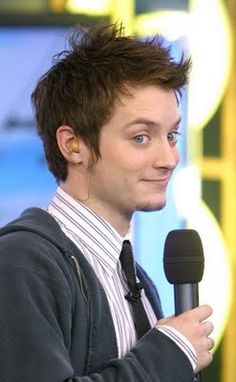 Elijah Wood. It's great when you find a picture of him where he doesn't look sad/worried/upset!