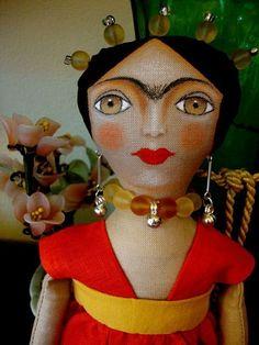 awesome fabric doll, looks like Freda Kahlo.