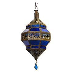 For Sale on - Moroccan metal and blue glass lantern in diamond shape. Moroccan lantern in octagonal shape with rust color metal finish and blue glass. The top and bottom Moroccan Hanging Lanterns, Moroccan Lighting, Hanging Chandelier, Metal Lanterns, Moroccan Chandelier, Modern Lanterns, Lanterns Decor, Moroccan Blue, Moroccan Decor