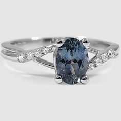 sapphire chamise ring in white gold is set with a rich teal oval sapphire
