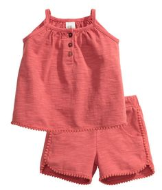 Check this out! BABY EXCLUSIVE. Set in soft, washed slub cotton jersey. Top with narrow shoulder straps, button placket, and pompom trim at hem. Shorts with elastication and decorative drawstring at waist, side pockets, and pompom trim at hems. - Visit hm.com to see more.