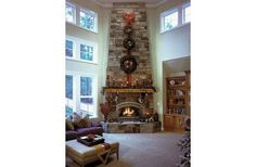 living room with angled fireplace | angled fireplace, two-story family with stacked windows