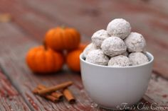 Pumpkin doughnut holes...These doughnut holes are full of great pumpkin spice flavor and covered with cinnamon powdered sugar. www.tinaschic.com