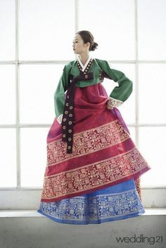 Hanbok- green jeogori, soft cherry chima over sky blue underskirt, multiple gold patterned hem bands