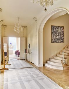 The entrance hall is highlighted by carefully preserved plaster palm trees, while the painting is by Sigmar Polke | archdigest.com