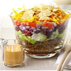 Potluck Taco Salad Recipe- Recipes I found this recipe in an old school cookbook, and I've taken it to many potlucks since then. The layers look so pretty in a glass bowl.Sandy Fynaardt, New Sharon, Iowa Taco Salad Recipes, Potluck Recipes, Mexican Food Recipes, Beef Recipes, Great Recipes, Cooking Recipes, Taco Bell Taco Salad Recipe, Potluck Ideas, Meal Ideas