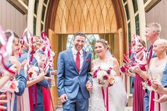 Red and blush ribbon wand wedding ceremony church exit | Rachel Laxton Photography