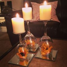 Wine glasses, mirrors and candles! cute decor for a student budget