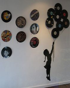 A girl holding old lp records, how cute! Could work as a seating chart?