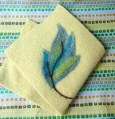 I've been doing a little experimenting with a new needle felting tool. I thought I'd whip up a little tutorial on a technique I came up with. This is the Clover needle felting mat and tool. Needle felting is usually done into a block of foam. This mat is like a stiff brush with a ...