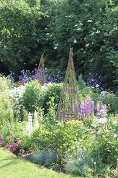 Obelisks in a cottage garden by bonnie
