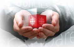 Hands holding a glass cube containing  a red cbc cube