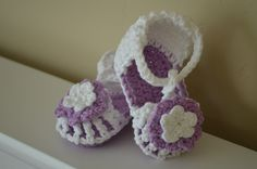 cotton crochet baby sandals in purple and white 0-6 months. $14.50, via Etsy.
