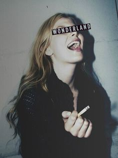 """I JUST WANNA BE IN WONDERLAND"" she screamed as she place a cigarette in between her lips-Rudy"