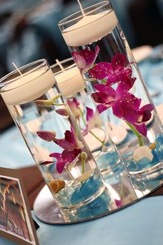 Flowers in floating candles set on top of reflective mirrors