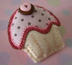 A Finished Felt Cupcake Pin Brooch made using a Free Printable Template Pattern and Tutorial.
