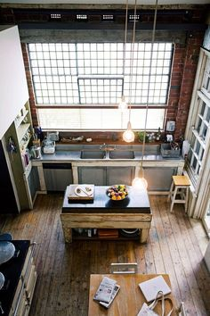 NYC is known for its loft apartments, converted from former factories. This kitchen combines industrial stainless steel with rustic timber for a truly eclectic space. *Photo: James Geer / bauersyndication.com.au*