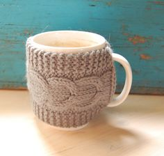 Knit coffee mug cozy with cable pattern, hand knitted.