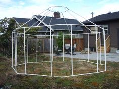 """pvc 'yurt' (tent) made with 24 x 45 degree joints, 24 T joints, 32 x 5"""" pipes, 8 x 6"""" pipes and 8 x 1"""" pipes...  apparently it all packs down into a snowboard bag! (or any 6"""" bag, really)"""