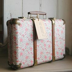 SUITCASE: A usually rectangular piece of luggage for carrying clothing.