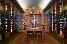 Gorgeous custom wine cellar with original wine crate panel back wall