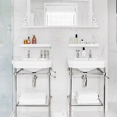 White and chrome bathroom with twin Victorian basins and stands