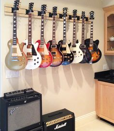 Guitar Hanger - One of these hangers in probably maple could be a lot better than the individual hangers I have now. Angling should save like 50 wall space. Guitar Wall Hanger, Guitar Rack, Guitar Display Wall, Home Music Rooms, Music Studio Room, Guitar Storage, Band Rooms, Recording Studio Design, Studio Interior