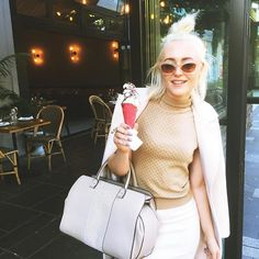 OBSESSED with @pinksalt soft serve!  Wearing @salsuli earrings and ring, @gucci turtleneck, @scanlantheodore skirt, @lanvinofficial brogues, @victoriabeckham bag, and @charliebrownofficial coat at #MBFWA #PinkSalt