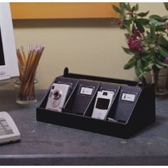 Cell Phone Charging station  http://www.amazon.com/Cell-Phone-Charging-Station-Black/dp/B001J1RRXW