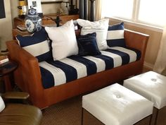 """My Beach house sofa recovered in """"cayman"""" faux leather and Ralph Lauren lighthouse stripe- pillows are Ralph Lauren pattern  Gulf Breeze and ottomans are covered in Kravet  pattern Lizagator"""