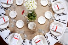 No table runner on these round tables. Instead a scalloped circle cut from brown paper; with seating assignments written on in chalk. The scalloped circle could be cut from fabric or colored paper to add color. Michigan Blue Dress Barn Wedding