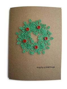 handmade Christmas card ... green snowflake wreath  on kraft paper with red bling berries ... JDooreCreations  on Etsy