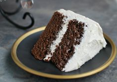 easy to prepare scratch made chocolate buttermilk cake is topped with luscious white chocolate frosting. Great go-to cake recipe for even a beginner baker.