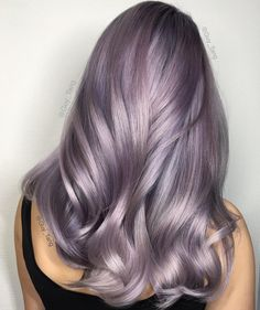 www.cosmopolitan.stfi.re beauty-hair hair news a44374 smokey-lilac-hair ?sf=yjeobne . Shiny glossy pastel lavender haircolor. With hints of pinks purples blues greys.