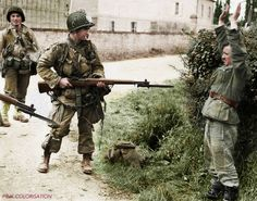 Pfc. Wilbur W. Shanklin RHQ Cº 506 PIR poses for the camera, guarding a soldier from the 795th Battalion (Georgian), 739 Grenadier Regt., 709th Inf Div., in Turqueville, Lower Normandy 7th June 1944 #infantry