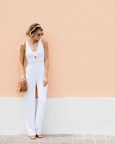 white jumpsuit + brown crossbody bag