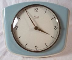 60s design: Original Kienzle Electric kitchen clock / wall clock made of ceramic. Made in Germany. Vintage