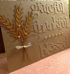 handmade Thanksgiving card: Grateful, Thankful, Blessed by Susie B .... kraft on kraft ... luv the look of stacked die cut words for the etched look ... die cut wheat stalks too ...