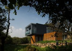 Grillagh water house by Patrick Bradly made of 4 stacked shipping containers in northern Irland