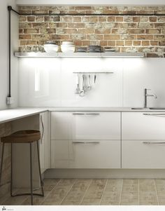 A clean take on the industrial trend. This spotless white gloss kitchen uses illuminated shelving to reflect light off the white glass splashback. Texture is used by keeping the original exposed brickwork and trunking for the electrics. A chunky solid wood and iron bar stool complete the designer look. Kitchen design inspiration by http://pix.setvisions.co.uk/Portfolio
