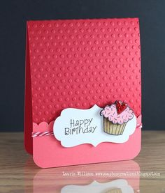 Cute Card -One bright color(three shades)-textured paper made with the Cuttle Bug Machine-Stripey Ribbon- And A white piece of paper announcing the occasion.