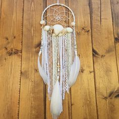 Shell dream catcher by Inspired Soul Shop On Etsy. This dream catcher was inspired by the ocean and beach. This handmade dream catcher is perfect for beach decor, bedroom, boho, nursery decor, and more. A shell dreamcatcher also makes a great birthday or baby shower gift.