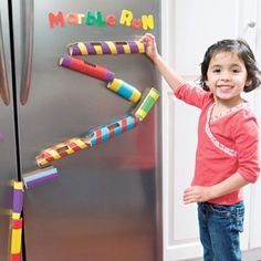 Toilet Paper Roll Marble Run    Use paper tubes in varying sizes, make window cut-outs with a craft knife, paint and/or decorate them, and place magnet strips to the backs to create this fun little marble run. Let the kids experiment and rearrange the tubes to see how many different ways they can get it to work.