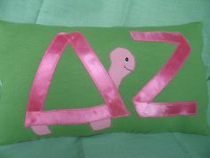 Delta Zeta pillow with Greek letters made from pink ribbon.