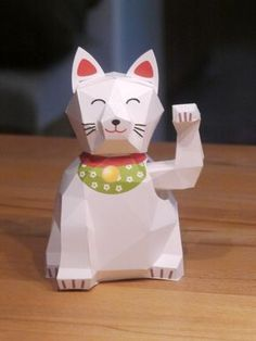 Maneki neko - papercraft lucky cat with movable arm. Free downloadable template - build yours today.