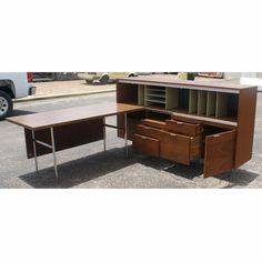 I want this mid-century desk. Look at all the compartments I can put junk in!